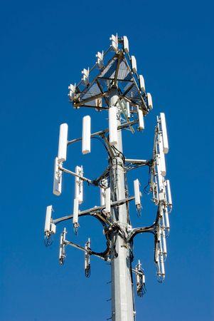 Brand new cellular transmission tower against a big blue sky.