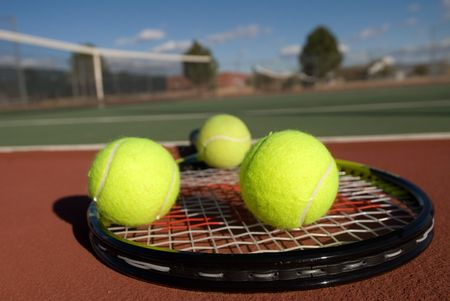 backhand: An image depicting the concept of tennis, including the court, racquets, balls and blue outdoors. Stock Photo