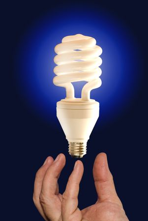 An illuminated light bulb floating in mid air provides a basis for conceptual thinking, ideas and creative minds.