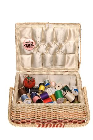 The concept of sewing and embroidery is highlighted by colorful spools of thread in mom's sewing basket.