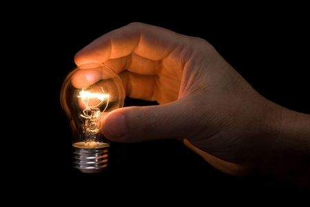 lighted: An actual lighted light bulb held in the hand of an engineer promoted idea generation and creative thinking inferences.