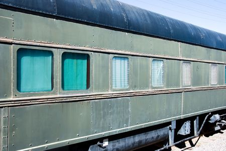 An old passenger train rests along a desert railway station. Stock Photo - 3139679
