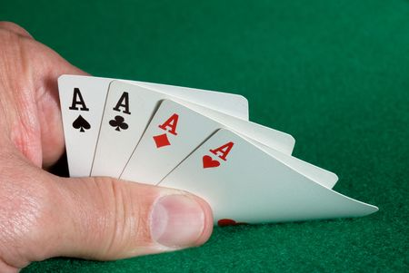 dealt: A card player is dealt a hand of four aces