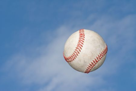 home run: A baseball flys through the air after being hit for the fence. Stock Photo