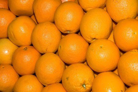 A bundle of fresh oranges at a local farmers market