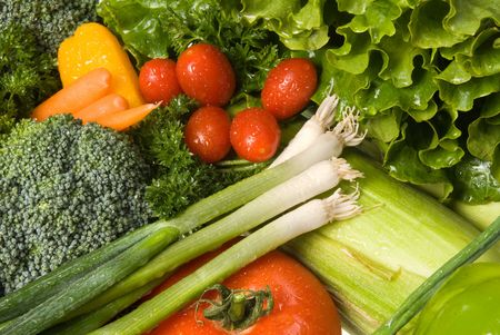 retain: Close up of a mix of color, fresh vegetables with cool water sprayed on them to retain freshness. Stock Photo