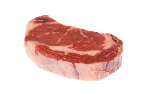 Beautiful cut of beef deliciously seasoned and ready to be grilled photo