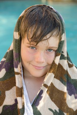 A child enjoys the summer by cooling off in a swimming pool. Stock Photo - 3820737