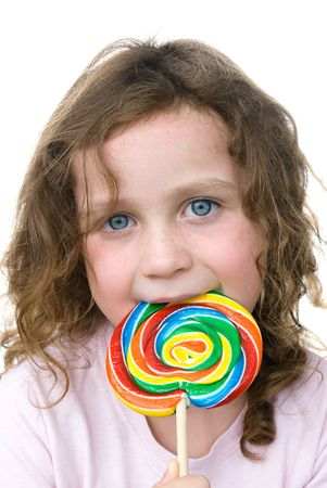 sucker: A young girl enjoys her lollipop pin wheel sucker.
