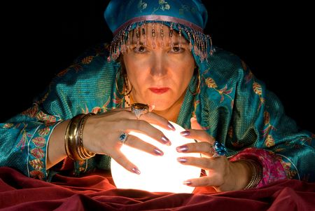 gypsy woman: A gypsy fortune teller brings her crystal ball to life to read the future. Stock Photo