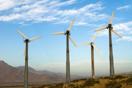 Wind power generating mills in the desert supply clean, renewable energy.