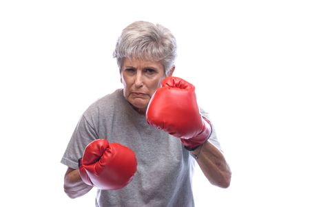 snarl: A mother shows who is boss by using her boxing gloves. Stock Photo