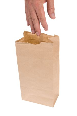 A man reaches into his lunch sack to grab his food.