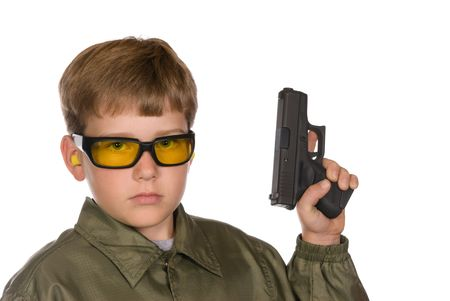 A boy is prepared to go shooting by wearing his safety glasses and hearing protection. Stock Photo - 3820230