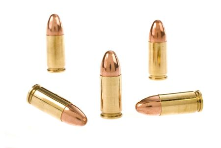 Bullets for a revolver pistol isolated on a white background.
