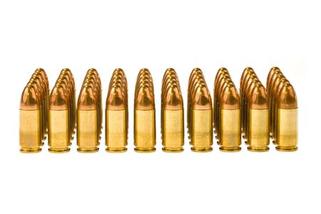 caliber: Rows of 45 caliber bullets isolated on a white background. Stock Photo