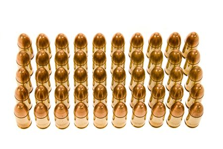 caliber: Rows of 45 caliber bullets isolated on a white backgrouns. Stock Photo