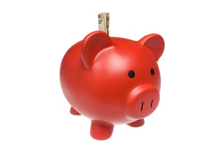 Red piggy bank isolated against a white background  Banco de Imagens