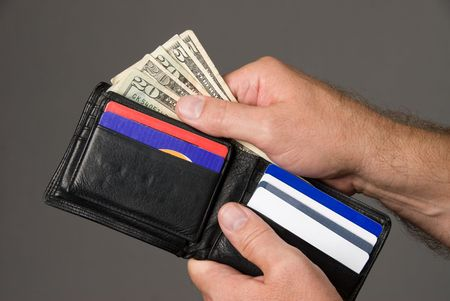 Dishing out cash from a leather wallet to pay bills