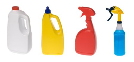 An assortment of plastic cleaning solution bottles isolated against white.  Stok Fotoğraf