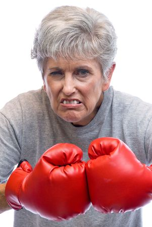 A mother shows who is boss by using her boxing gloves. Stock Photo - 3820748