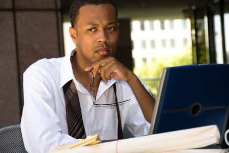 An executive engineer conducting work during his lunch hour. Stock Photo - 3820343