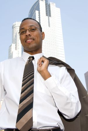 A businessman relaxes and throws his jacket over his shoulder. Stock Photo - 3820357