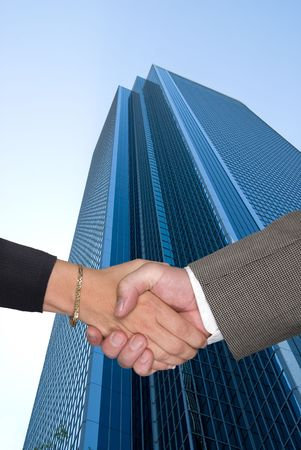 Male and female partners shaking hands after a negotiating a contract agreement  photo