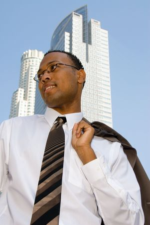 A businessman relaxes and throws his jacket over his shoulder. Stock Photo - 3820337