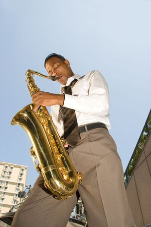 A saxophone player shows off his talents during a lunchtime presentation. photo