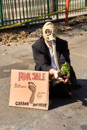 A man protests the environmental condition of his city.