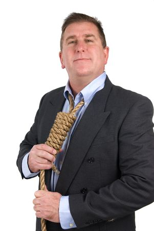 A man getting ready for his final day of work by tying his noose necktie.