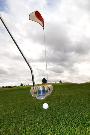 inclement weather: A golfer putting in stormy weather