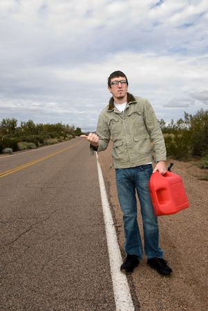 way out: A young man hitchikes to catch a ride for some gasoline.