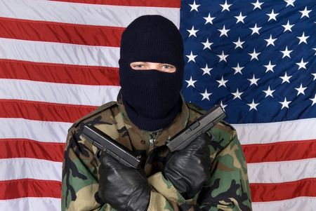 finger on trigger: An American stands prepared to protect his country from terrorism with his handguns.