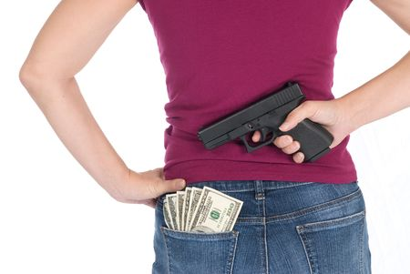 A woman stands ready to protect her cash with a gun Stock Photo - 4360672