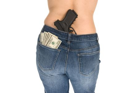 A woman prepares herself to protect her money. Stock Photo - 4360669