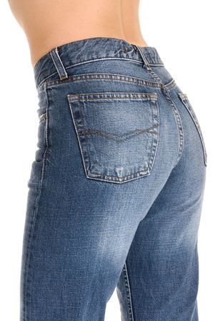 A young woman with her tight fitting jeans. photo