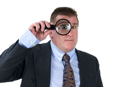 A man inspects things with his magnifying glass, which shows his enlarghed eye. Stock Photo - 4360842