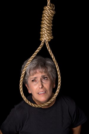 An elderly woman prepares to commit suicide by hanging. Stock Photo - 4365017