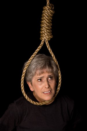 A depressed elderly woman prepares to commit suicide Stock Photo - 4365016