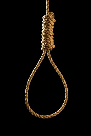 execution: An execution or suicide noose isolated on black and backlit for a dark mood Stock Photo