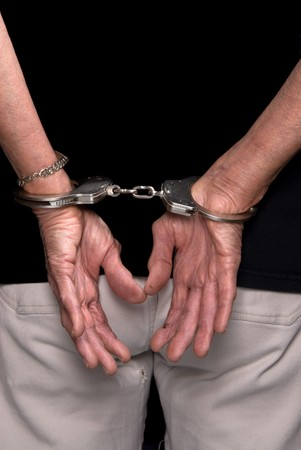 An elderly woman is handcuffed, showing that crime happens at any age. Stock Photo - 4369408