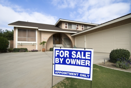 A home is being sold during tough economic times. Stock Photo