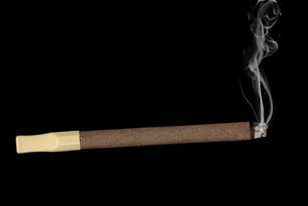 inference: A lit cigar with a mouth filter and rising tobacco smoke isolated on black. Good for any smoking inference.