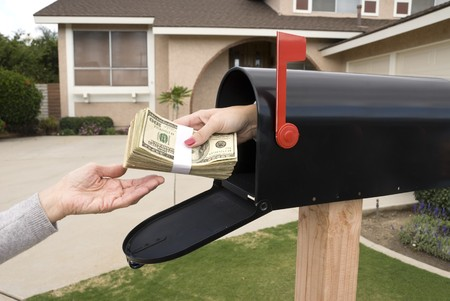 A bundle of cash is being delivered to a homeowner waiting for an economic stimulus payment or property bailout money. Stock Photo - 4369381
