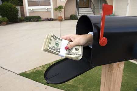 A bundle of cash is being delivered to a homeowner waiting for an economic stimulus payment or foreclosure bailout. Stock Photo