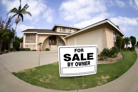 A home is put up for sale in tough economic times.