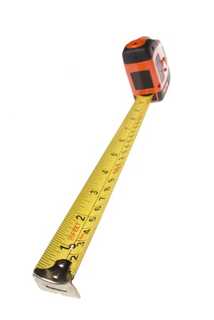 A new tape measure isolated on a white background can be used for any measurement or carpentry inference. Stock Photo - 4369230