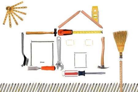 A tool montage of a house and garage with a sun and a tree and a picket fence isolated on white. photo